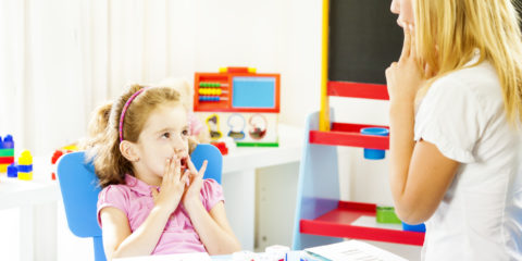 Speech Therapist helping child